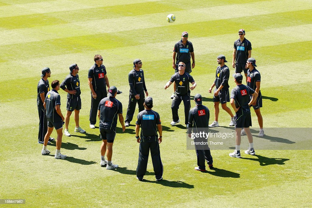 Australian players warm up by playing a football game during an Australian training session at Sydney Cricket Ground on January 1, 2013 in Sydney, Australia.