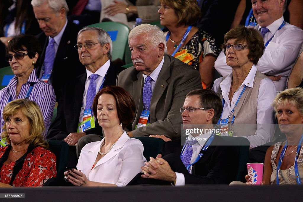 Australian PM Julia Gillard checks her mobile 'phone whilst she watches the men's semifinal match between Andy Murray of Great Britain and Novak Djokovic of Serbia during day twelve of the 2012 Australian Open at Melbourne Park on January 27, 2012 in Melbourne, Australia.