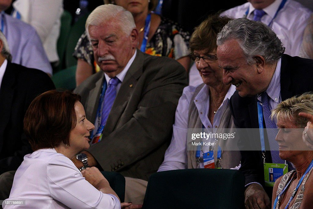 Australian PM Julia Gillard meets tennis great Margaret Court (in glasses) whilst she watches the men's semifinal match between Andy Murray of Great Britain and Novak Djokovic of Serbia during day twelve of the 2012 Australian Open at Melbourne Park on January 27, 2012 in Melbourne, Australia.