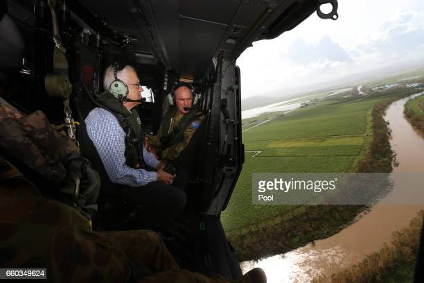Australian PM Malcolm Turnbull and Opposition Leader Bill Shorten visit a cyclone damaged area March 30 2017 in Bowen Australia