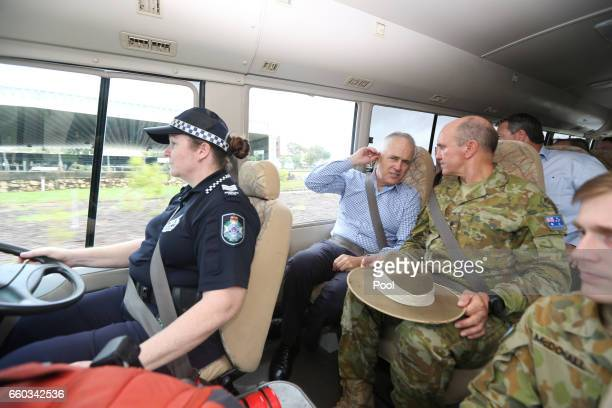 Australian PM Malcolm Turnbull and State Recovery Coordinator Brigadier Chris Field visit a cyclone damaged area March 30 2017 in Bowen Australia