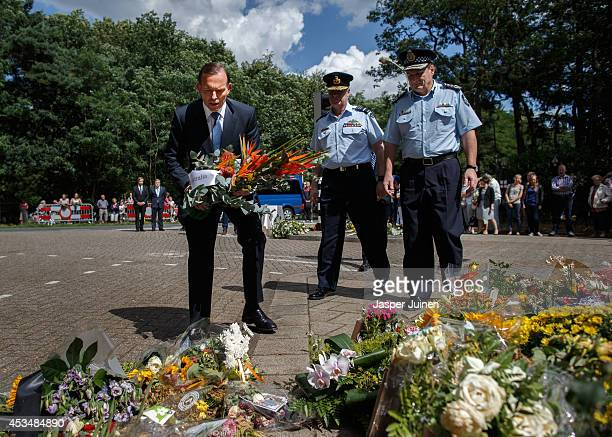Australian PM Tony Abbott lays a lays a wreath in remembrance of the victims of Malaysia Airlines flight MH17 on August 11 2014 in Hilversum...