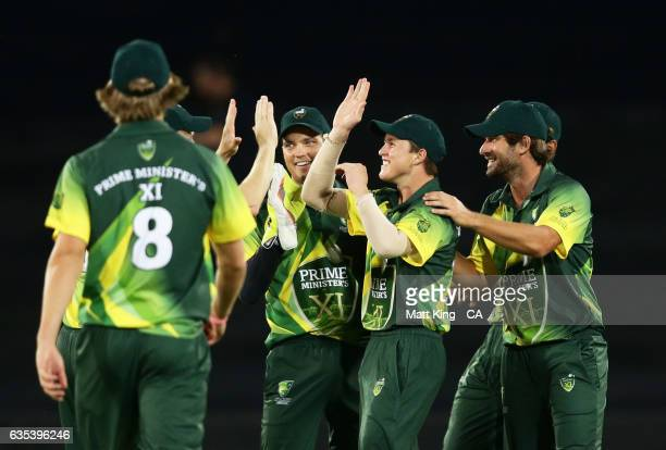 Australian PMXI players celebrate the runout of Asela Gunaratne of Sri Lanka during the T20 warm up match between the Australian PM's XI and Sri...