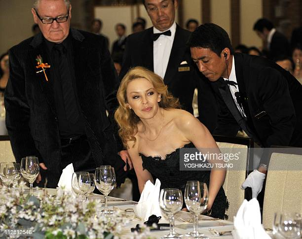 Australian pop icon Kylie Minogue takes her seat at a fund raising dinner for the victims of the tsunami and massive earthquake in Tokyo on April 22...