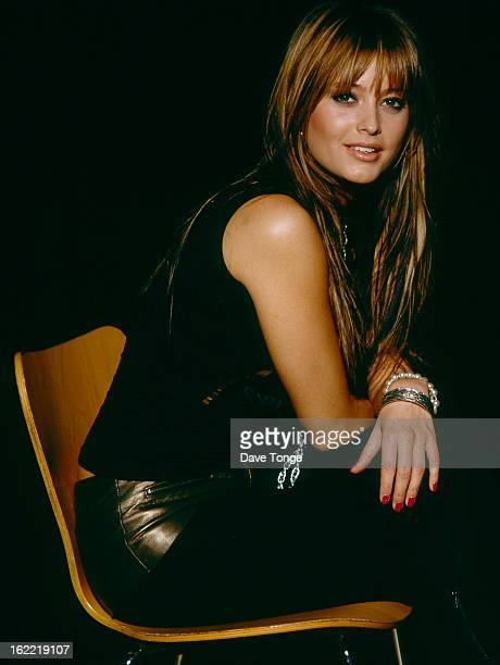 Australian pop singer Holly Valance poses for portraits London 2002