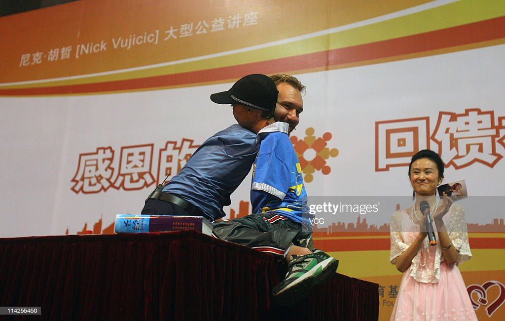 Australian preacher and motivational speaker <a gi-track='captionPersonalityLinkClicked' href=/galleries/search?phrase=Nick+Vujicic&family=editorial&specificpeople=5126580 ng-click='$event.stopPropagation()'>Nick Vujicic</a> hugs a disabled child during his public lecture at Zhongnan University of Economics and Law on May 16, 2011 in Wuhan, Hubei Province of China.