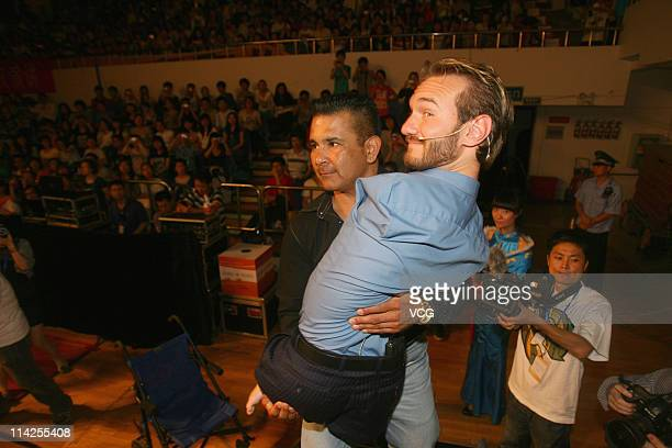 Australian preacher and motivational speaker Nick Vujicic is lifted onto a platform before his public lecture at Zhongnan University of Economics and...