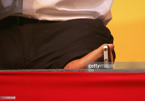 XI'AN CHINA MAY 15 Australian preacher and motivational speaker Nick Vujicic plays a cellphone during his public lecture at Northwestern...