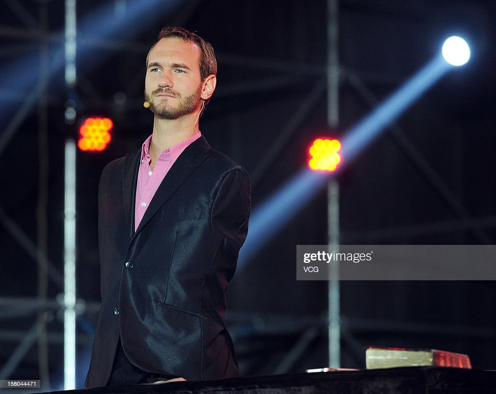 Australian preacher and motivational speaker <a gi-track='captionPersonalityLinkClicked' href=/galleries/search?phrase=Nick+Vujicic&family=editorial&specificpeople=5126580 ng-click='$event.stopPropagation()'>Nick Vujicic</a> speaks to an audience during his public lecture at Zhengzhou International Convention and Exhibition Center on December 9, 2012 in Zhengzhou, China.