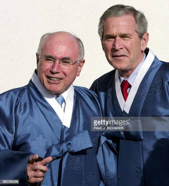 Australian Premier John Howard ans US President George W Bush chat after the Asia Pacific Economic Cooperation leaders' official photo at the...