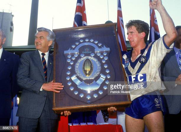 Australian Prime Minister Bob Hawke congratulates Bulldogs captain Steve Mortimer after winning the 1985 NSWRL Grand Final between the St George...