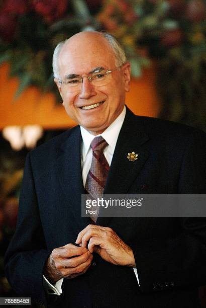 Australian Prime Minister John Howard ahead of official group dialogue sessions on day seven of the AsiaPacific Economic Cooperation meeting in...