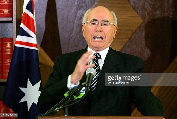 Australian Prime Minister John Howard gestures during a press conference in Melbourne 09 September 2004 where he announces that he will be sending...