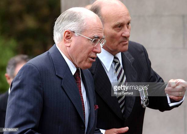 Australian Prime Minister John Howard left with Andrew RentonGreen on his way to wreathlaying ceremony at National War Memorial Wellington Monday