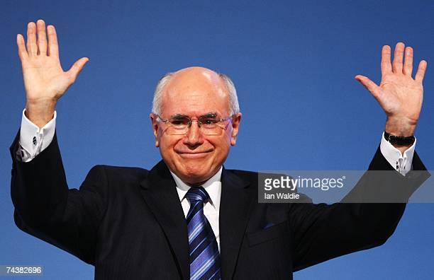Australian Prime Minister John Howard waves to the party faithful after his keynote speech to the Liberal Party of Australia's Federal Council June 3...