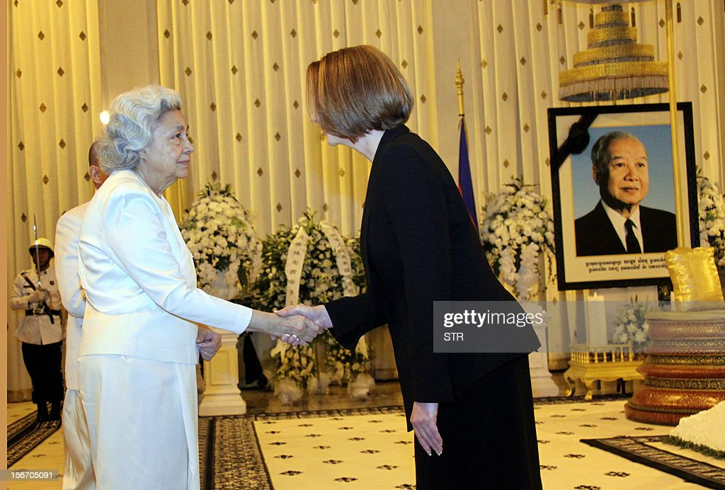 Australian Prime Minister Julia Eileen Gillard (R) condoles the late former Cambodian King Norodom Sihanouk's widow Queen Monique after the Australia leader paid his respects at the coffin of the late former King Norodom Sihanouk at the Royal Palace in Phnom Penh on November 19, 2012. Julia is in Phnom Penh for the East Asia Summit in the Cambodian capital where the 10 leaders of the Association of Southeast Asian (ASEAN) are gathered for the 21st ASEAN Summit.