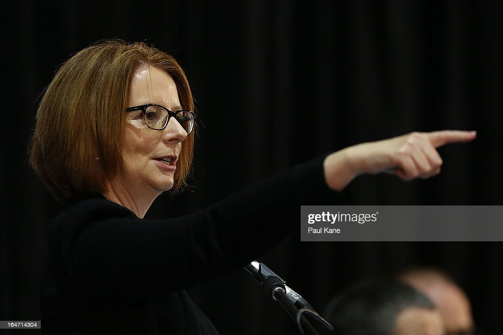 Australian Prime Minister <a gi-track='captionPersonalityLinkClicked' href=/galleries/search?phrase=Julia+Gillard&family=editorial&specificpeople=787281 ng-click='$event.stopPropagation()'>Julia Gillard</a> addresses invited guests at Thornlie Senior High School on March 27, 2013 in Perth, Australia. Gillard held a community cabinet meeting with members of her new front bench in the suburb of Thornlie today, in her first visit to WA since the Labor party lost state elections.