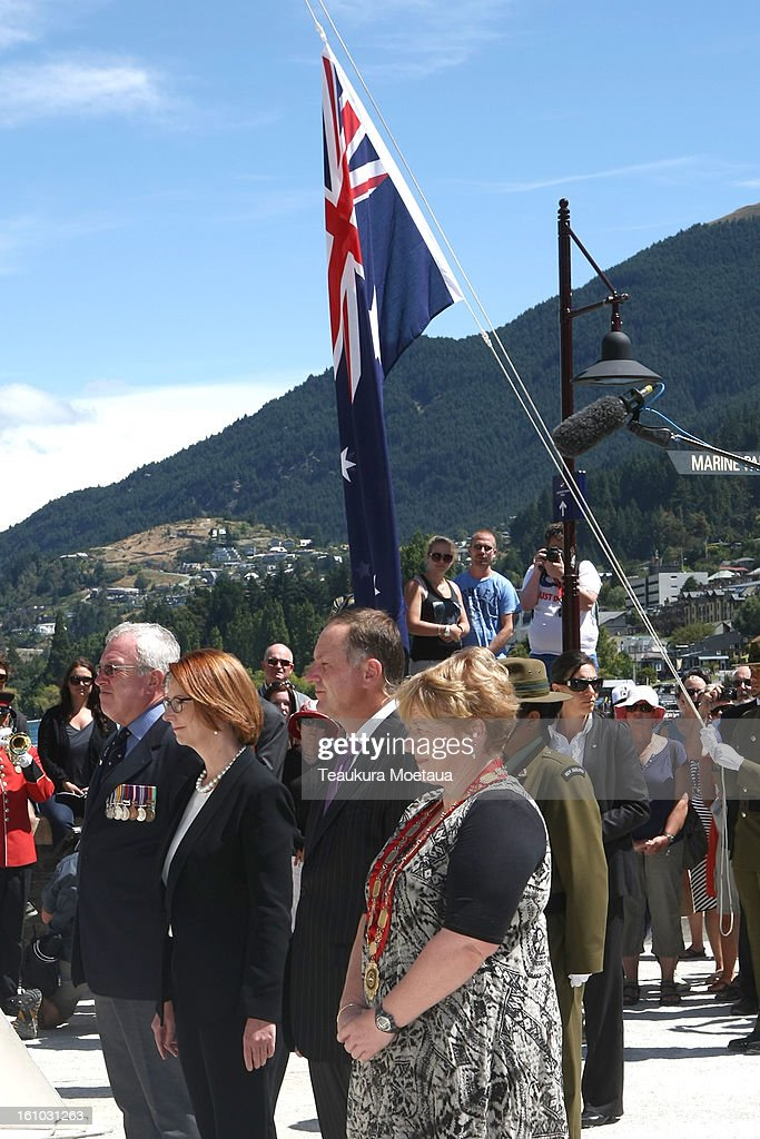Australian Prime Minister Julia Gillard (2nd L) and New Zealand Prime Minister John Key (C) look on during laying of the Wreaths at Queenstown War Memorial on February 9, 2013 in Queenstown, New Zealand. The annual talks are held over two days, with the economy and Asia-pacific defence matters as key items on the agenda.