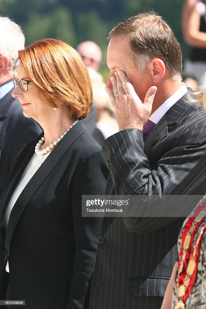 Australian Prime Minister <a gi-track='captionPersonalityLinkClicked' href=/galleries/search?phrase=Julia+Gillard&family=editorial&specificpeople=787281 ng-click='$event.stopPropagation()'>Julia Gillard</a> and New Zealand Prime Minister <a gi-track='captionPersonalityLinkClicked' href=/galleries/search?phrase=John+Key&family=editorial&specificpeople=2246670 ng-click='$event.stopPropagation()'>John Key</a> (C) pay their respects during laying of the Wreaths at Queenstown War Memorial on February 9, 2013 in Queenstown, New Zealand. The annual talks are held over two days, with the economy and Asia-pacific defence matters as key items on the agenda.