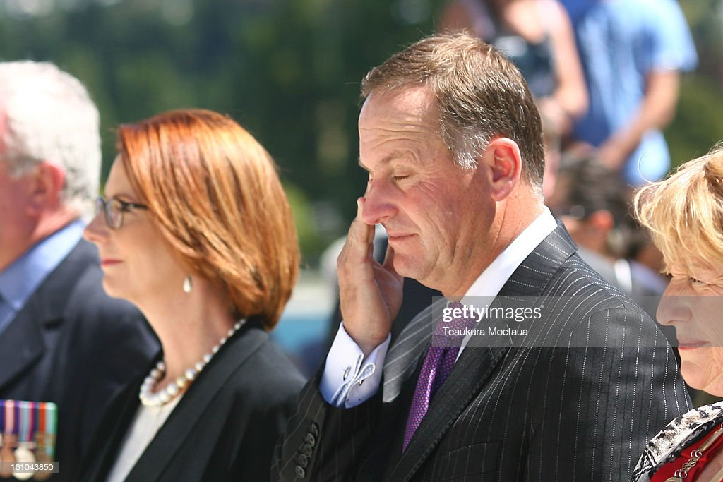 Australian Prime Minister Julia Gillard and New Zealand Prime Minister John Key (C) pay their respects during laying of the Wreaths at Queenstown War Memorial on February 9, 2013 in Queenstown, New Zealand. The annual talks are held over two days, with the economy and Asia-pacific defence matters as key items on the agenda.