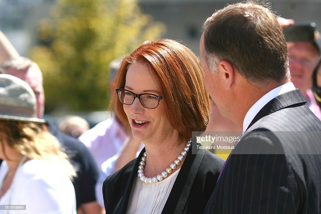 Australian Prime Minister Julia Gillard (L) and New Zealand Prime Minister John Key (R) look on before laying of the Wreaths at Queenstown War Memorial on February 9, 2013 in Queenstown, New Zealand. The annual talks are held over two days, with the economy and Asia-pacific defence matters as key items on the agenda.