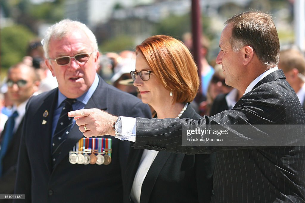 Australian Prime Minister Julia Gillard (C) and New Zealand Prime Minister John Key (R) look on during laying of the Wreaths at Queenstown War Memorial on February 9, 2013 in Queenstown, New Zealand. The annual talks are held over two days, with the economy and Asia-pacific defence matters as key items on the agenda.