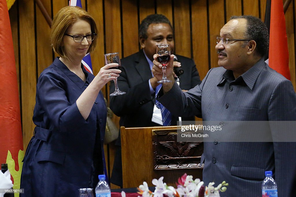 Australian Prime Minister <a gi-track='captionPersonalityLinkClicked' href=/galleries/search?phrase=Julia+Gillard&family=editorial&specificpeople=787281 ng-click='$event.stopPropagation()'>Julia Gillard</a> and Papua New Guinea Prime Minister, Peter O'Neill share a toast during a state dinner held at Parliament House on May 9, 2013 in Port Moresby, Papua New Guinea. The trip is the first official visit for Prime Minister <a gi-track='captionPersonalityLinkClicked' href=/galleries/search?phrase=Julia+Gillard&family=editorial&specificpeople=787281 ng-click='$event.stopPropagation()'>Julia Gillard</a> to the Pacific Island Nation and the first visit since former prime minster Kevin Rudd visited in 2007. The three-day visit will include trips to a local market and primary school as well as tours of the Exxon Mobil Liquefied Natural Gas plant and the Bomana War Cemetery.