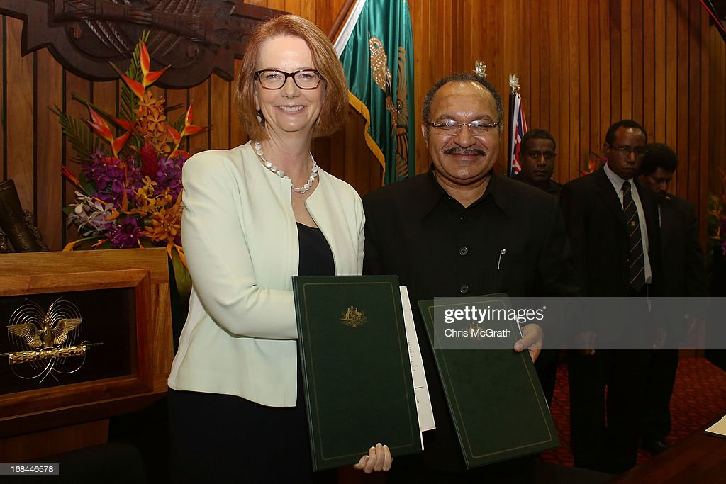 Australian Prime Minister Julia Gillard and Papua New Guinea Prime Minister Peter O'Neill pose after signing a joint declaration at Parliament House on May 10, 2013 in Port Moresby, Papua New Guinea. The three-day visit is a chance for the two nations to strengthen economic ties, with talks being held on key issues including, trade, military defense, and the controversial Australian detention center on Manus Island. The trip is the first official visit for Prime Minister Julia Gillard to the Pacific Island Nation and the first visit since former prime minster Kevin Rudd visited in 2007.