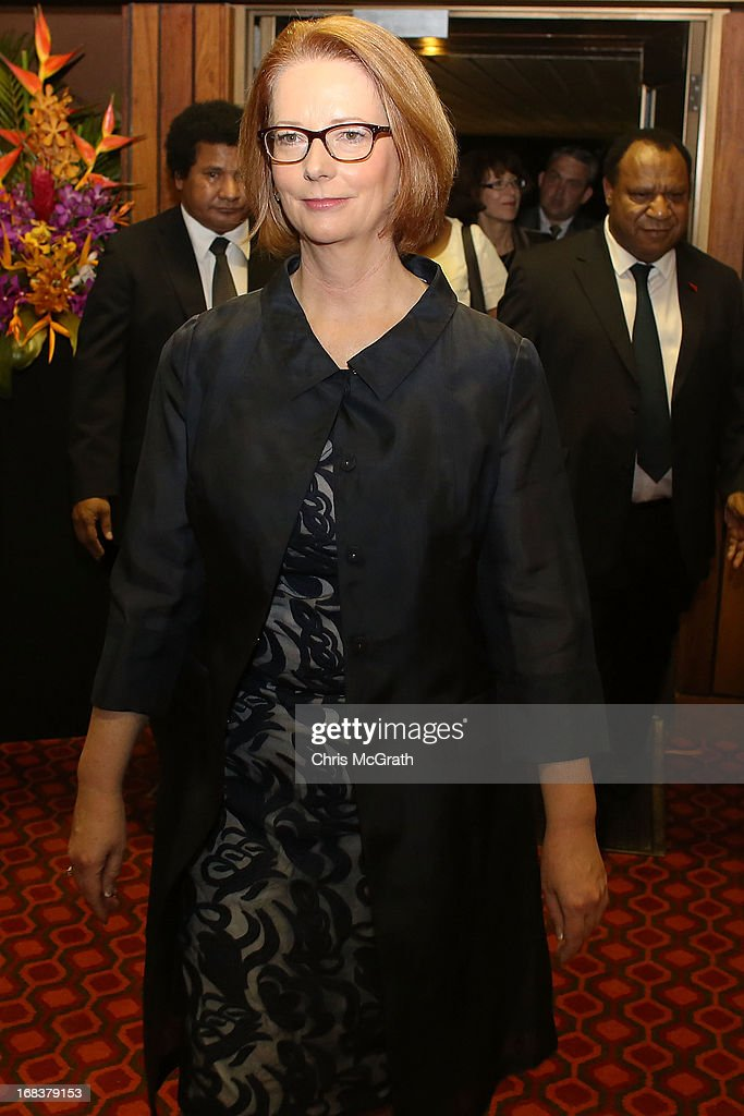 Australian Prime Minister <a gi-track='captionPersonalityLinkClicked' href=/galleries/search?phrase=Julia+Gillard&family=editorial&specificpeople=787281 ng-click='$event.stopPropagation()'>Julia Gillard</a> arrives for a state dinner held at Parliament House on May 9, 2013 in Port Moresby, Papua New Guinea. The trip is the first official visit for Prime Minister <a gi-track='captionPersonalityLinkClicked' href=/galleries/search?phrase=Julia+Gillard&family=editorial&specificpeople=787281 ng-click='$event.stopPropagation()'>Julia Gillard</a> to the Pacific Island Nation and the first visit since former prime minster Kevin Rudd visited in 2007. The three-day visit will include trips to a local market and primary school as well as tours of the Exxon Mobil Liquefied Natural Gas plant and the Bomana War Cemetery.