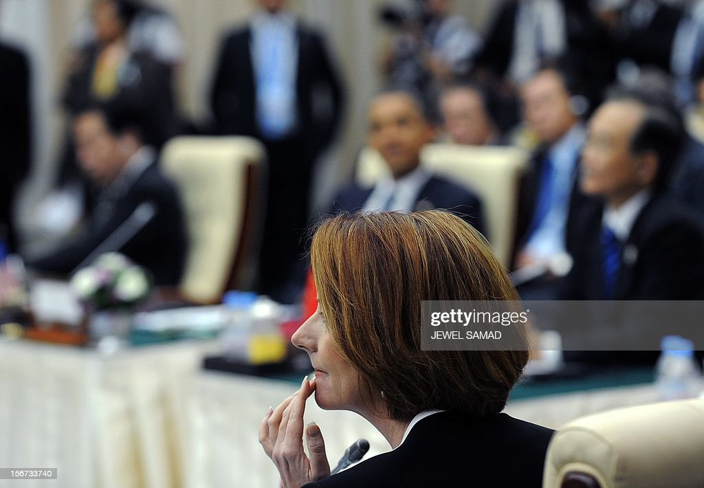 Australian Prime Minister Julia Gillard (C) attends an East Asian Summit Plenary Session at the Peace Palace in Phnom Penh on November 20, 2012. Cambodian is hosing the 21st Association of Southeast Asian Nations (ASEAN) Summit and Related Summits. AFP PHOTO/Jewel Samad