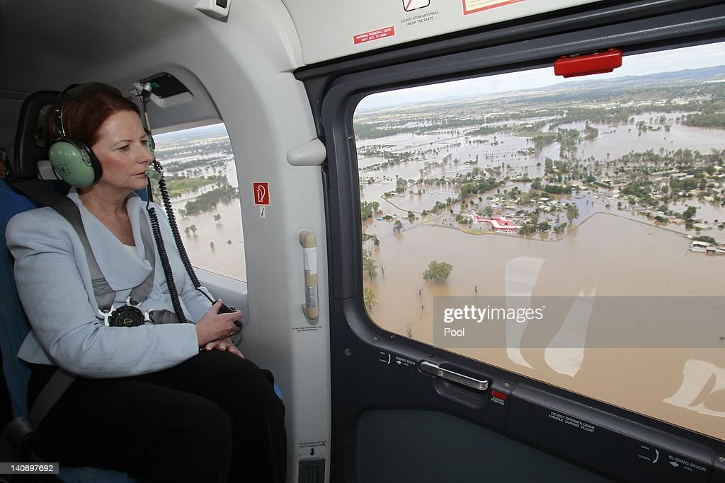 Australian Prime Minister <a gi-track='captionPersonalityLinkClicked' href=/galleries/search?phrase=Julia+Gillard&family=editorial&specificpeople=787281 ng-click='$event.stopPropagation()'>Julia Gillard</a> flies over floodwaters that are inundating Wagga Wagga on March 7, 2012 in Wagga Wagga, Australia. 9000 evacuated residents are waiting for authorities to survey the city's levee to determine if it is safe to return home, after flood waters peaked at 10.6 metres - less than the 10.9 metre peak predicted. Residents on Monday were instructed to evacuate and the town was declared a disaster zone with authorities predicting floodwaters to reach a level that would likely break the levee, flood the cities central district, and cause the worst flooding in decades.