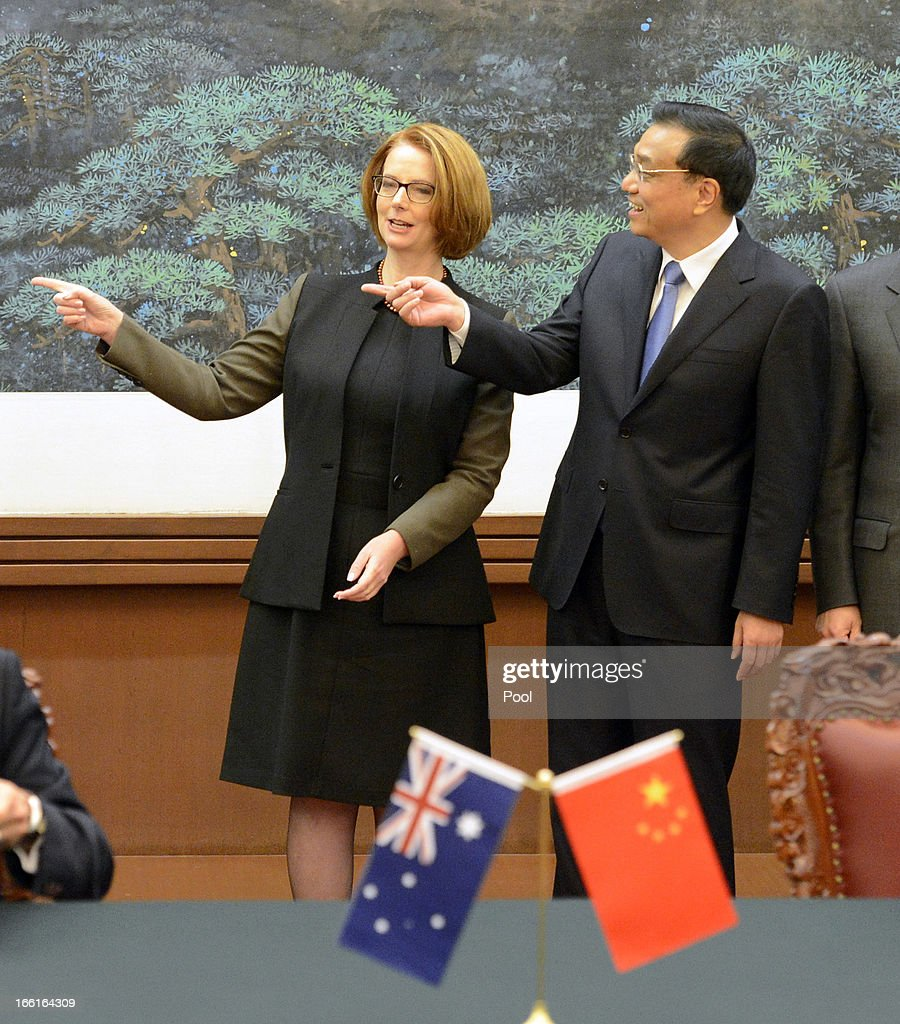 Australian Prime Minister Julia Gillard gestures with Chinese Premier Li Keqiang during a meeting at the Great Hall of the People on April 9, 2013 in Beijing, China. Gillard spoke of building stronger defense ties with China.