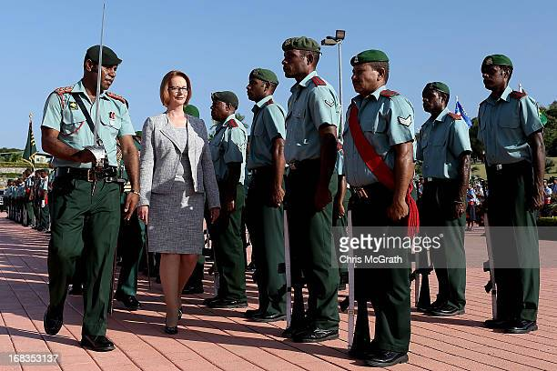 Australian Prime Minister Julia Gillard inspects the honour guard after arriving at Jackson International Airport on May 9 2013 in Port Moresby Papua...