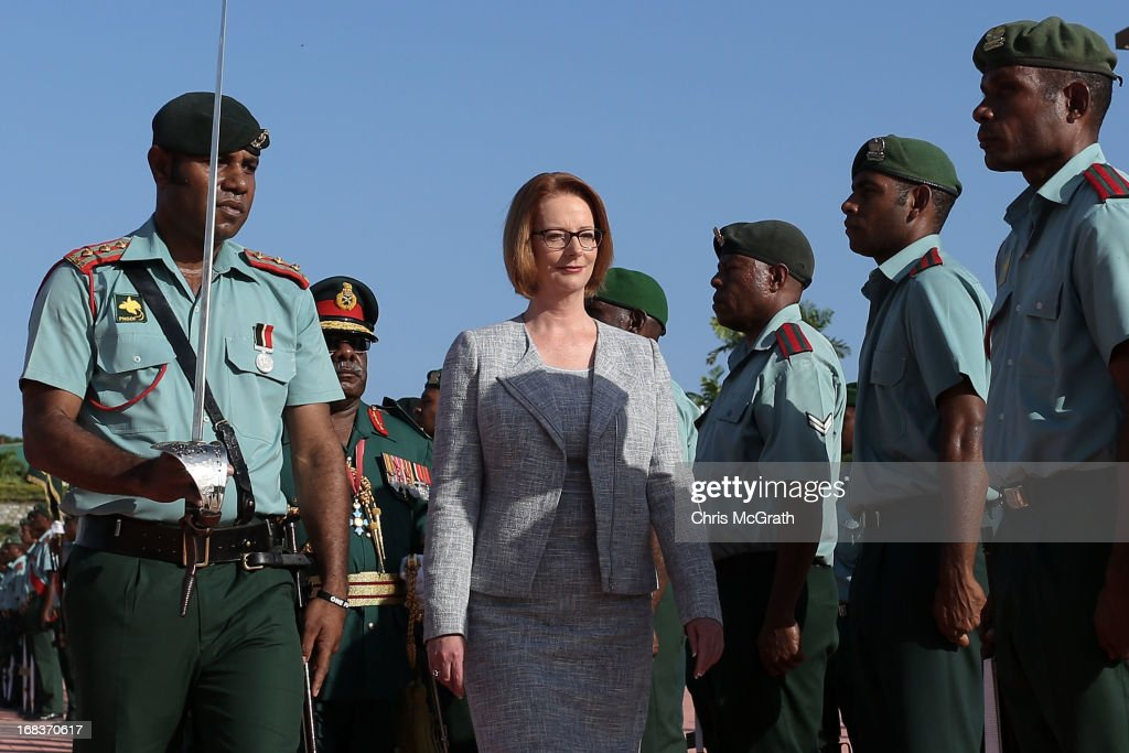 Australian Prime Minister <a gi-track='captionPersonalityLinkClicked' href=/galleries/search?phrase=Julia+Gillard&family=editorial&specificpeople=787281 ng-click='$event.stopPropagation()'>Julia Gillard</a> inspects the honour guard after arriving at Jackson International Airport on May 9, 2013 in Port Moresby, Papua New Guinea. The trip is the first official visit for Prime Minister <a gi-track='captionPersonalityLinkClicked' href=/galleries/search?phrase=Julia+Gillard&family=editorial&specificpeople=787281 ng-click='$event.stopPropagation()'>Julia Gillard</a> to the Pacific Island Nation and the first visit since former prime minster Kevin Rudd visited in 2007. The three-day visit will include trips to a local market and primary school as well as tours of the Exxon Mobil Liquefied Natural Gas plant and the Bomana War Cemetery.