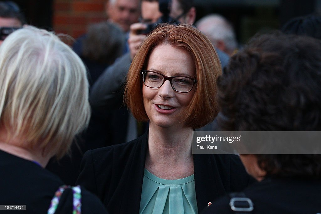 Australian Prime Minister Julia Gillard is greeted by well wishers at Thornlie Senior High School on March 27, 2013 in Perth, Australia. Gillard held a community cabinet meeting with members of her new front bench in the suburb of Thornlie today, in her first visit to WA since the Labor party lost state elections.