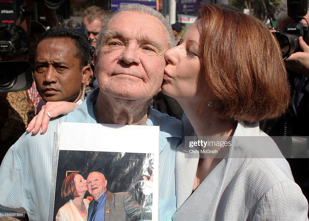 Australian Prime Minister <a gi-track='captionPersonalityLinkClicked' href=/galleries/search?phrase=Julia+Gillard&family=editorial&specificpeople=787281 ng-click='$event.stopPropagation()'>Julia Gillard</a> jokes around with 77 year old Ray Briggs, of Australia during her visit to the Bali Bombing Memorial at Jalan Legian, Bali, on October 13, 2012 in Indonesia. Mr Briggs traveled to Bali for the 10th anniversary ceremonies and brought with him a photograph in which the Prime Minister gave him a kiss during the 2011 Korean Anzac Veterans service in Korea. The Prime Ministers visit brings to a close the official 10th anniversary ceremonies for the families of those killed in the 2002 Kuta bombings which killed 202 people including 88 Australians.