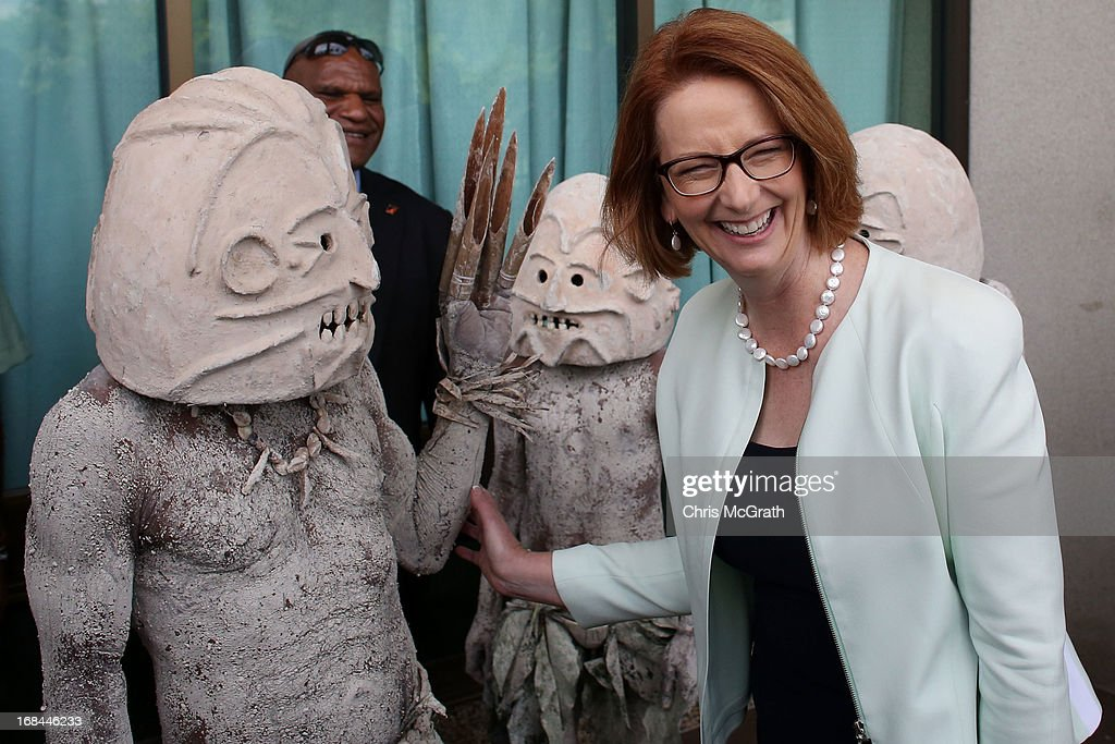 Australian Prime Minister Julia Gillard jokes around with members of the Goroka Asaro Mud Men dancers after meeting with Papua New Guinea Prime Minister Peter O'Neill at Parliament House on May 10, 2013 in Port Moresby, Papua New Guinea. The three-day visit is a chance for the two nations to strengthen economic ties, with talks being held on key issues including, trade, military defense, and the controversial Australian detention center on Manus Island. The trip is the first official visit for Prime Minister Julia Gillard to the Pacific Island Nation and the first visit since former prime minster Kevin Rudd visited in 2007.
