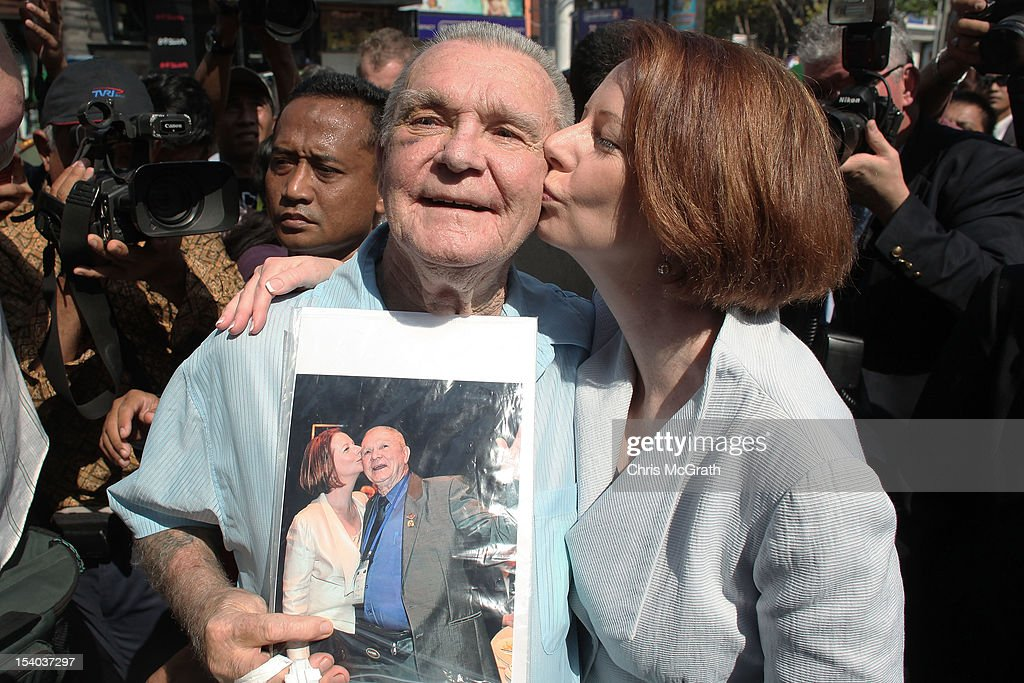 Australian Prime Minister <a gi-track='captionPersonalityLinkClicked' href=/galleries/search?phrase=Julia+Gillard&family=editorial&specificpeople=787281 ng-click='$event.stopPropagation()'>Julia Gillard</a> kisses 77 year old Ray Briggs, of Australia during her visit to the Bali Bombing Memorial at Jalan Legian, Bali, on October 13, 2012 in Indonesia. Mr Briggs traveled to Bali for the 10th anniversary ceremonies and brought with him a photograph in which the Prime Minister gave him a kiss during the 2011 Korean Anzac Veterans service in Korea. The Prime Ministers visit brings to a close the official 10th anniversary ceremonies for the families of those killed in the 2002 Kuta bombings which killed 202 people including 88 Australians.