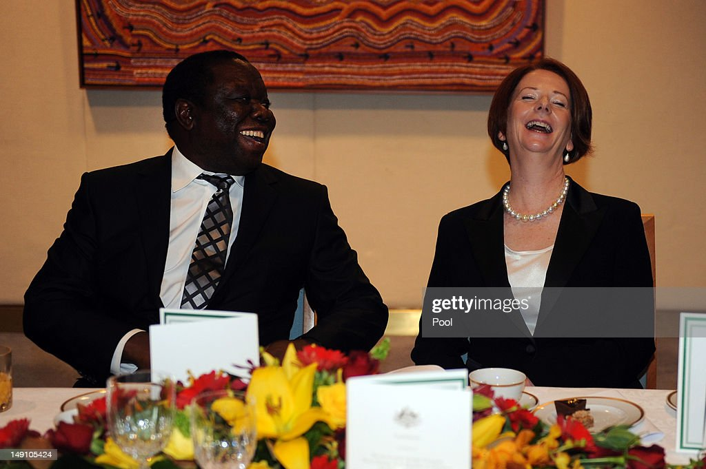 Australian Prime Minister <a gi-track='captionPersonalityLinkClicked' href=/galleries/search?phrase=Julia+Gillard&family=editorial&specificpeople=787281 ng-click='$event.stopPropagation()'>Julia Gillard</a> laughs with the Prime Minister of Zimbabwe <a gi-track='captionPersonalityLinkClicked' href=/galleries/search?phrase=Morgan+Tsvangirai&family=editorial&specificpeople=800701 ng-click='$event.stopPropagation()'>Morgan Tsvangirai</a> during a lunch on July 23, 2012 in Canberra, Australia. Australia is the third largest donor to Zimbabwe with assistance focused on water, sanitation and economic growth.