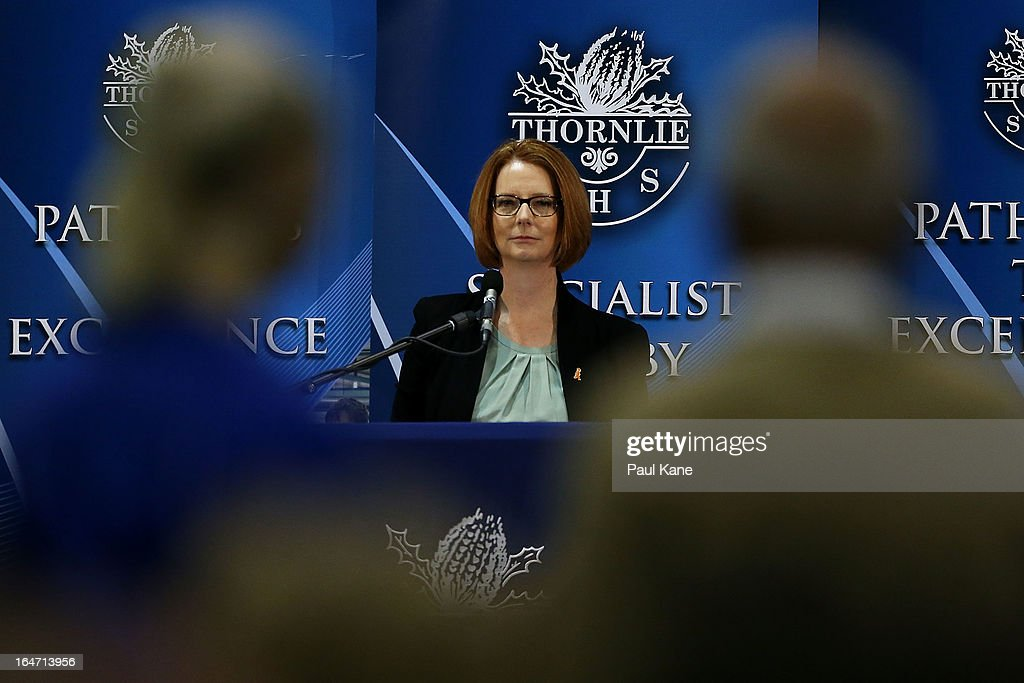 Australian Prime Minister <a gi-track='captionPersonalityLinkClicked' href=/galleries/search?phrase=Julia+Gillard&family=editorial&specificpeople=787281 ng-click='$event.stopPropagation()'>Julia Gillard</a> listens to a question from a member of the public at Thornlie Senior High School on March 27, 2013 in Perth, Australia. Gillard held a community cabinet meeting with members of her new front bench in the suburb of Thornlie today, in her first visit to WA since the Labor party lost state elections.