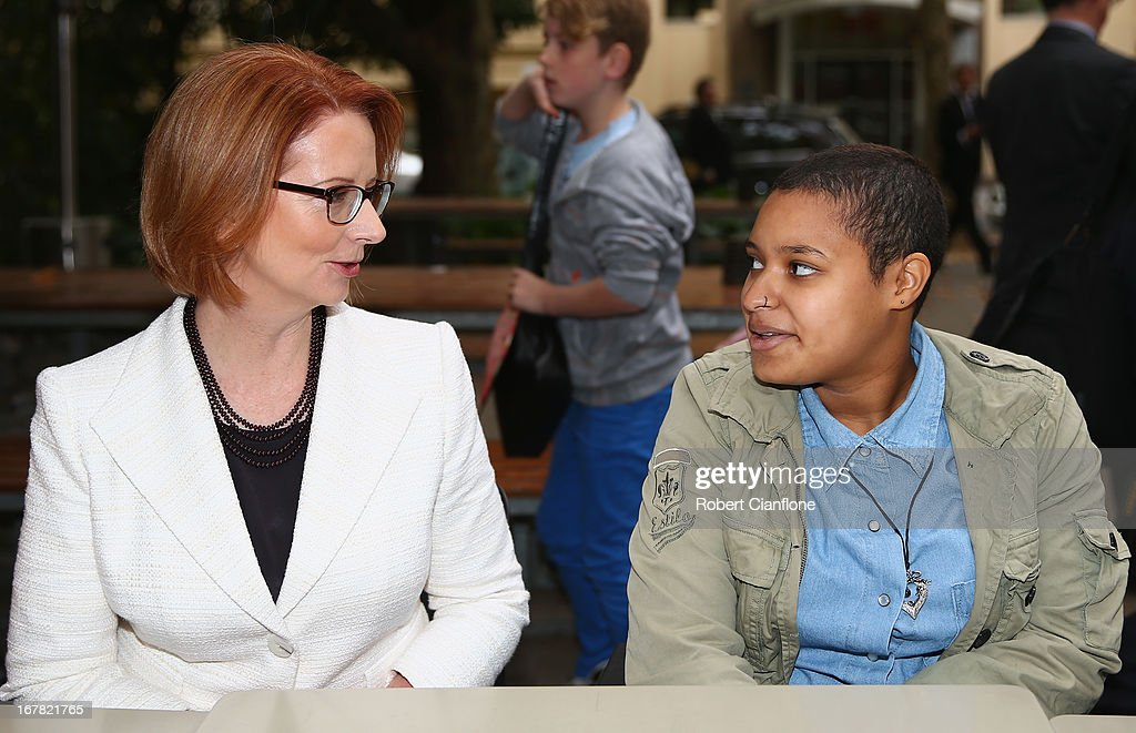 Australian Prime Minister <a gi-track='captionPersonalityLinkClicked' href=/galleries/search?phrase=Julia+Gillard&family=editorial&specificpeople=787281 ng-click='$event.stopPropagation()'>Julia Gillard</a> meets members from the disabled community after a press conference at the Commonwealth Parliamentary Office on May 1, 2013 in Melbourne, Australia. Gillard has announced that the Federal Government will increase the Medicare levy on income tax from 1.5 to two percent to help fund the National Disability Insurance Scheme (NDIS). The levy will begin on July 1, 2014 and is expected to raise around $3.2 billion annually towards the NDIS which is expected to cost $8 billion per year.