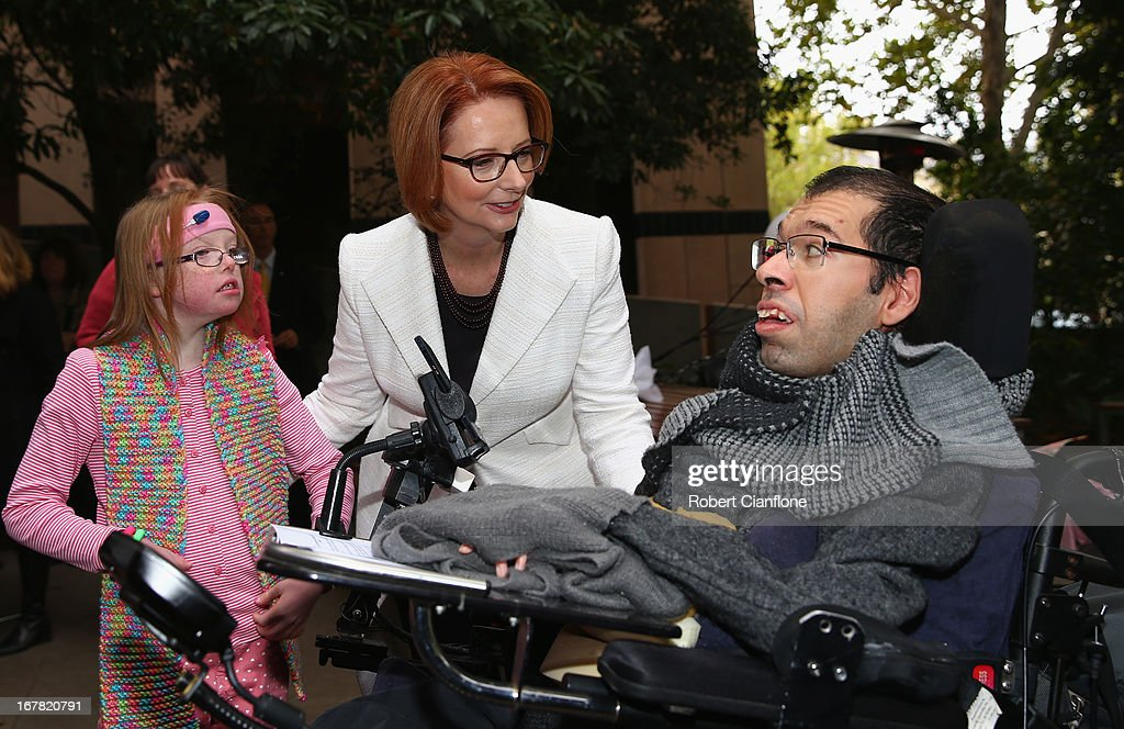 Australian Prime Minister <a gi-track='captionPersonalityLinkClicked' href=/galleries/search?phrase=Julia+Gillard&family=editorial&specificpeople=787281 ng-click='$event.stopPropagation()'>Julia Gillard</a> meets Sophie Dean (L) and Dr George Taleporos (R) from the disabled community after a press conference at the Commonwealth Parliamentary Office on May 1, 2013 in Melbourne, Australia. Gillard has announced that the Federal Government will increase the Medicare levy on income tax from 1.5 to two percent to help fund the National Disability Insurance Scheme (NDIS). The levy will begin on July 1, 2014 and is expected to raise around $3.2 billion annually towards the NDIS which is expected to cost $8 billion per year.