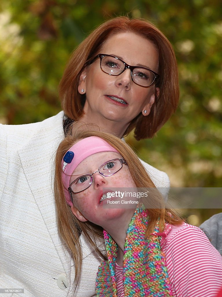 Australian Prime Minister <a gi-track='captionPersonalityLinkClicked' href=/galleries/search?phrase=Julia+Gillard&family=editorial&specificpeople=787281 ng-click='$event.stopPropagation()'>Julia Gillard</a> meets Sophie Dean from the disabled community after a press conference at the Commonwealth Parliamentary Office on May 1, 2013 in Melbourne, Australia. Gillard has announced that the Federal Government will increase the Medicare levy on income tax from 1.5 to two percent to help fund the National Disability Insurance Scheme (NDIS). The levy will begin on July 1, 2014 and is expected to raise around $3.2 billion annually towards the NDIS which is expected to cost $8 billion per year.