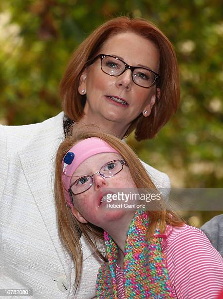 Australian Prime Minister Julia Gillard meets Sophie Dean from the disabled community after a press conference at the Commonwealth Parliamentary...
