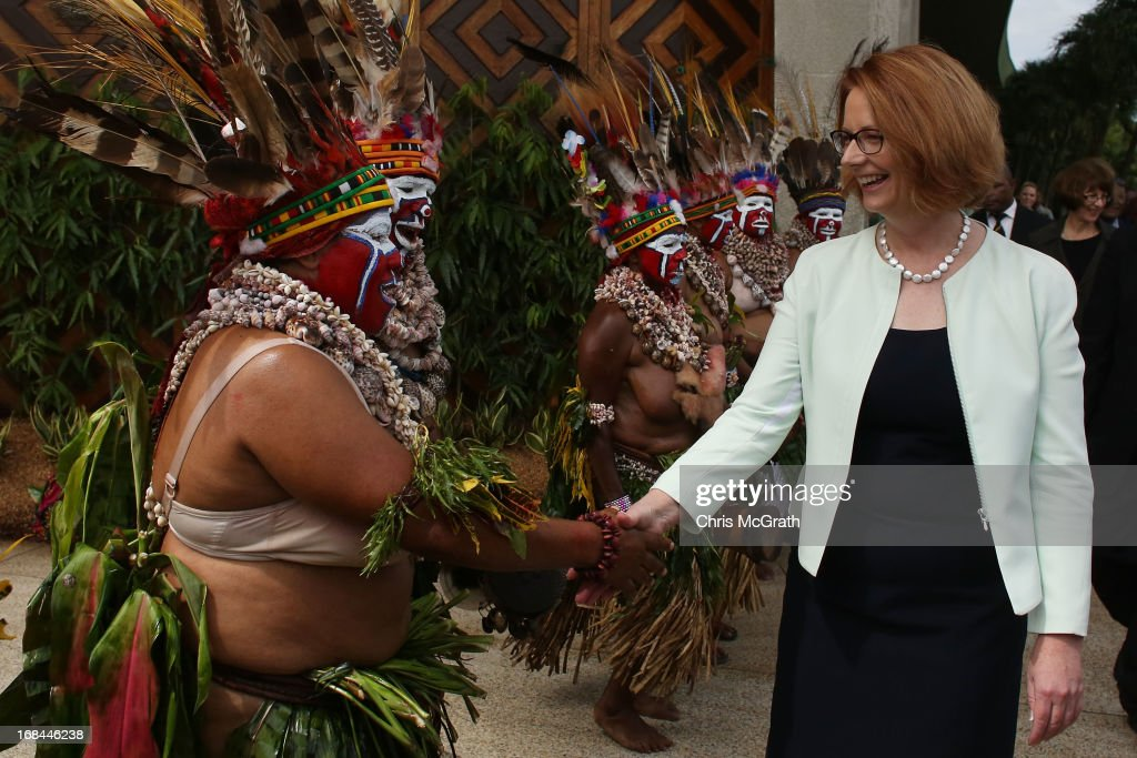 Australian Prime Minister <a gi-track='captionPersonalityLinkClicked' href=/galleries/search?phrase=Julia+Gillard&family=editorial&specificpeople=787281 ng-click='$event.stopPropagation()'>Julia Gillard</a> meets with traditional dancers after meeting with Papua New Guinea Prime Minister Peter O'Neill at Parliament House on May 10, 2013 in Port Moresby, Papua New Guinea. The three-day visit is a chance for the two nations to strengthen economic ties, with talks being held on key issues including, trade, military defense, and the controversial Australian detention center on Manus Island. The trip is the first official visit for Prime Minister <a gi-track='captionPersonalityLinkClicked' href=/galleries/search?phrase=Julia+Gillard&family=editorial&specificpeople=787281 ng-click='$event.stopPropagation()'>Julia Gillard</a> to the Pacific Island Nation and the first visit since former prime minster Kevin Rudd visited in 2007.