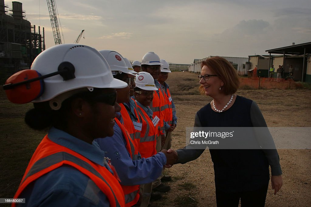 Australian Prime Minister <a gi-track='captionPersonalityLinkClicked' href=/galleries/search?phrase=Julia+Gillard&family=editorial&specificpeople=787281 ng-click='$event.stopPropagation()'>Julia Gillard</a> meets workers during a tour of the Exxon-Mobil Liquefied Natural Gas plant on May 10, 2013 in Port Moresby, Papua New Guinea. The three-day visit is a chance for the two nations to strengthen economic ties, with talks being held on key issues including, trade, military defense, and the controversial Australian detention center on Manus Island.The trip is the first official visit for Prime Minister <a gi-track='captionPersonalityLinkClicked' href=/galleries/search?phrase=Julia+Gillard&family=editorial&specificpeople=787281 ng-click='$event.stopPropagation()'>Julia Gillard</a> to the Pacific Island Nation and the first visit since former prime minster Kevin Rudd visited in 2007.