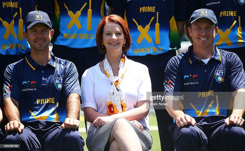 Australian Prime Minister Julia Gillard (C) poses for a team photo with Ricky Ponting (L) and Brad Haddin (R) before the International Tour Match between the Prime Minister's XI and West Indies at Manuka Oval on January 29, 2013 in Canberra, Australia.