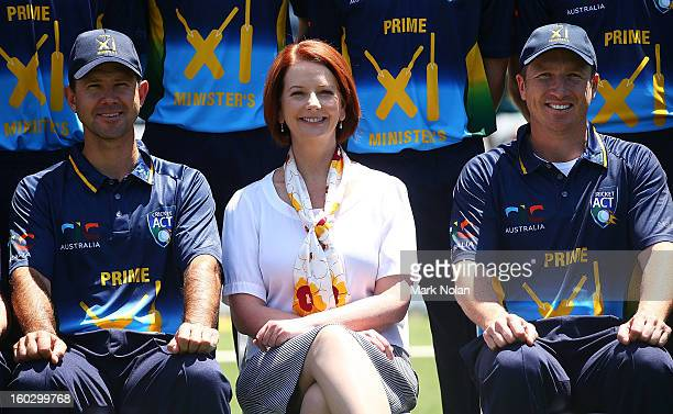 Australian Prime Minister Julia Gillard poses for a team photo with Ricky Ponting and Brad Haddin before the International Tour Match between the...