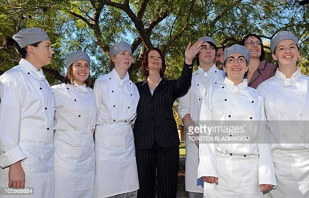 Australian Prime Minister Julia Gillard poses with apprentice chefs during her visit to Richmond High School�s Trades Training Centre near Sydney on...