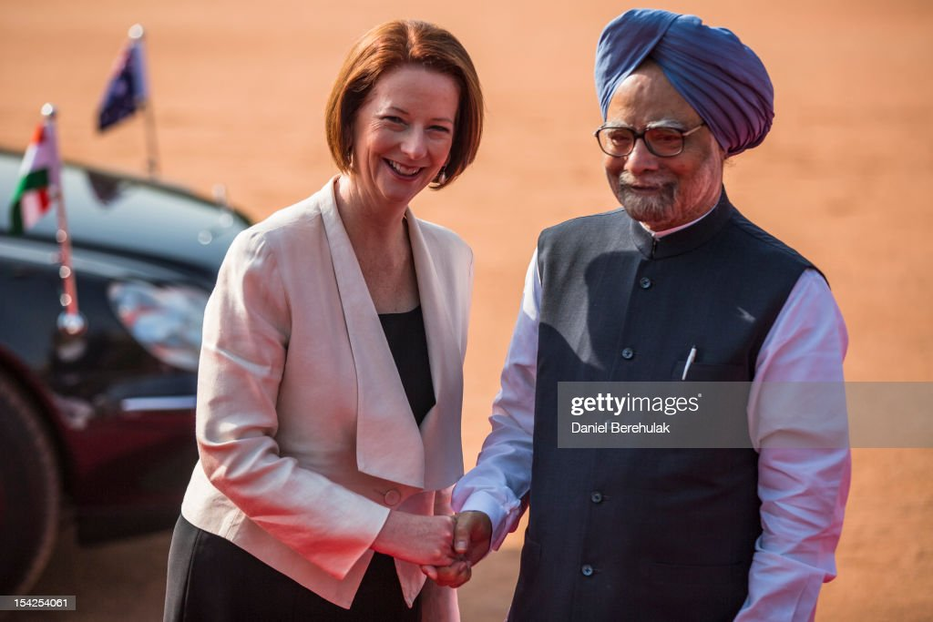 Australian Prime Minister <a gi-track='captionPersonalityLinkClicked' href=/galleries/search?phrase=Julia+Gillard&family=editorial&specificpeople=787281 ng-click='$event.stopPropagation()'>Julia Gillard</a> poses with Indian Prime Minister <a gi-track='captionPersonalityLinkClicked' href=/galleries/search?phrase=Manmohan+Singh&family=editorial&specificpeople=227120 ng-click='$event.stopPropagation()'>Manmohan Singh</a> during her ceremonial reception at the Indian presidential palace Rashtrapati Bhavan on October 17, 2012 in Delhi, India. Gillard is on an official three day visit to India where she is expected to discuss the sale of uranium to the nuclear armed country.